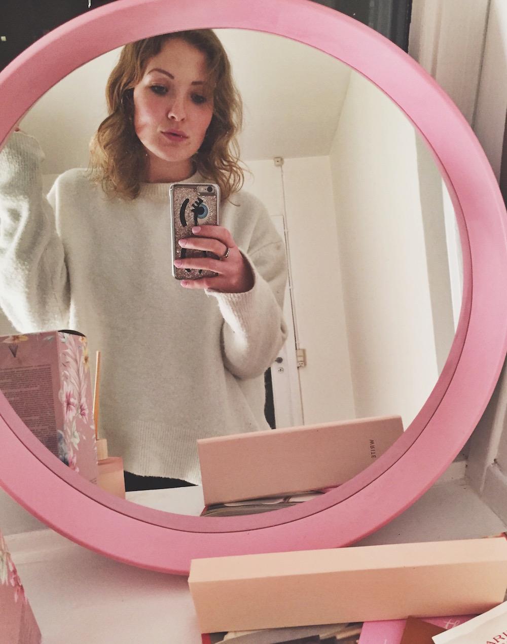Pink round mirror